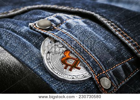 Bitcoin Coin In Your Jeans Pocket. Bitcoin Is The Most Popular Cryptocurrency In The World. Bitcoin