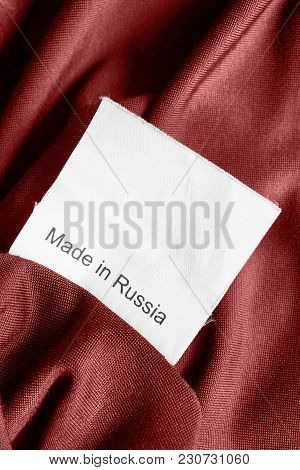 Clothes Label Lettered Made In Russia On Red Sain Background Closeup