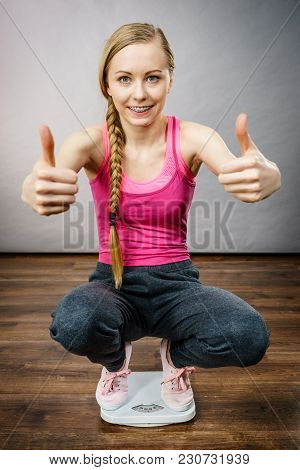 Teenage Woman On Bathroom Scale Machine Thinking About Weight Loss And Proper Body Mass Showing Thum