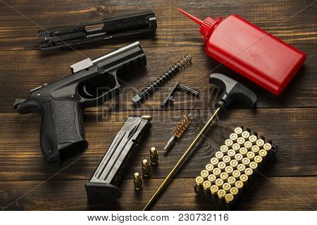 The Pistol Is In Disassembled Form Lying On The Table. The Cleaning Process. A Ramrod, Oil, Cartridg
