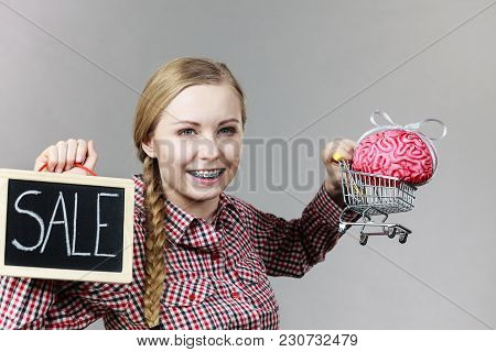Happy Woman Holding Shopping Cart With Brain Inside And Sale Sign. Clever, Responsible Buying Concep