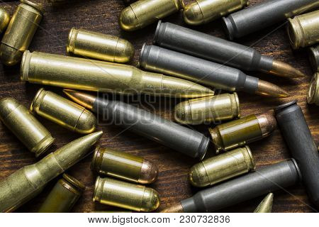 Cartridges Of Different Calibers On A Wooden Table