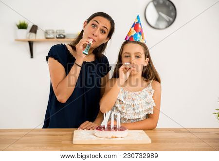 Shot of a mother and daughter in the kitchen celebrating Daughter's birthday
