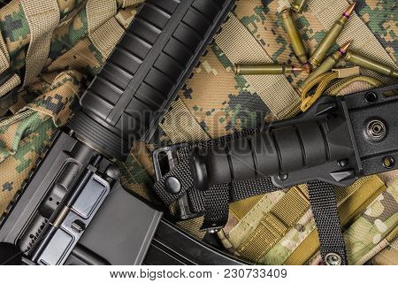 Automatic Rifle Lying On A Backpack With A Knife