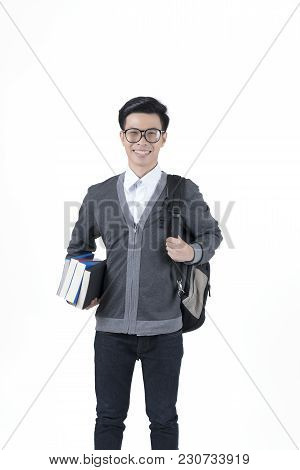 Smiling Young Asian Male Student In Grey Jacket Holding Books And Carrying Backpack Isolated On Whit