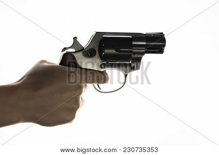 Isolated Revolver In Hand On A White Background