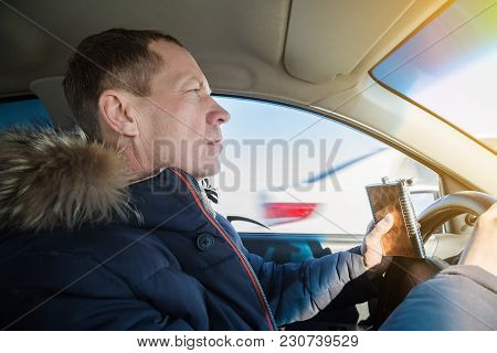 The Driver Of An Alcoholic Drinks Cognac While Driving A Car.