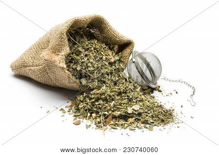 Green Tea Mixture In Juta Bag With Infuser On White Background