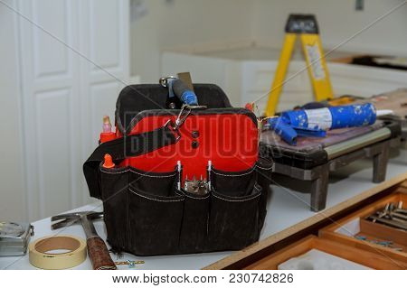 Set Of Tools In A Bag On Wooden Background, Close Up Of Tools On A Tool