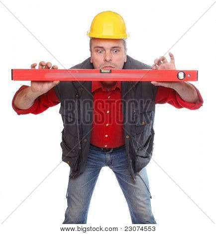 Funny picture of a worker with spirit-level on a white background.