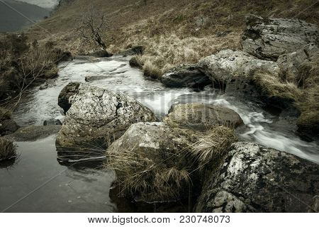 Nature, Rural Winter  Landscape With Running Water Brook Winding Through Hills And Valley
