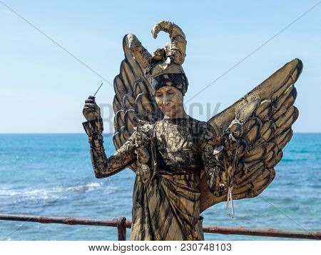 Caesarea, Israel, March 03, 2018 :  A Participant Of The Purim Festival Stands Dressed In A Fairy St