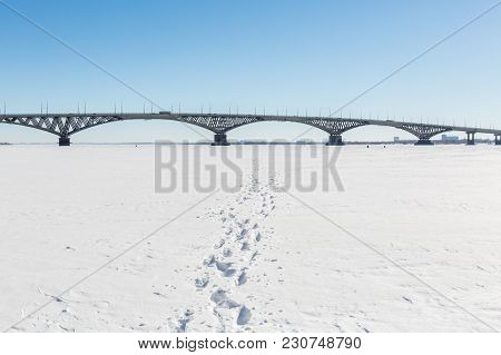 Road Bridge Across The Volga River Between The Cities Of Saratov And Engels. Winter Day. Ice On The