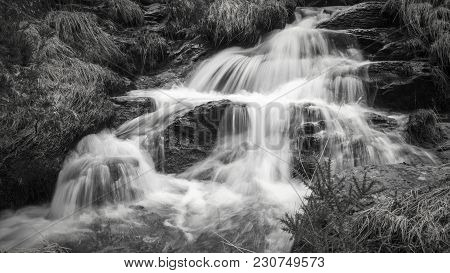 Nature, Rural Winter  Landscape With Running Water Brook And Waterfall Flowing Through Rocks,