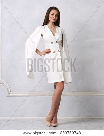 Attractive Brunette Female Model Wearing Mini White Dress With Golden Buttons, Split, Long Hanging S