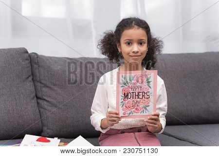 African American Kid Showing Greeting Card For Mothers Day