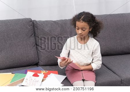 African American Kid Looking At Greeting Card For Mothers Day