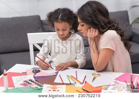 African American Mother Looking How Daughter Drawing Greeting Card On Mothers Day