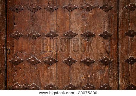 old wooden door with metal ornate background