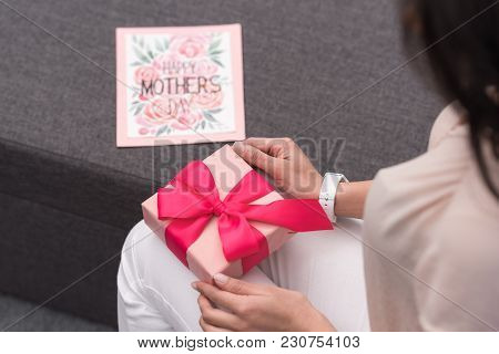 Cropped Image Of African American Mother Opening Present On Mothers Day