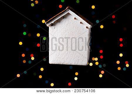Little Model House On A Bokeh Ligh Ton A Dark Background