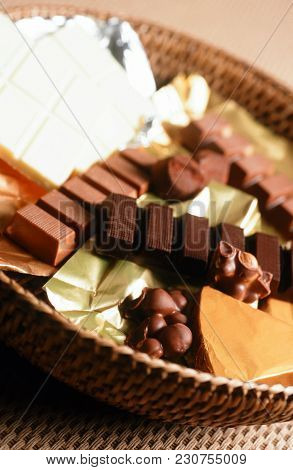 Different Packed And Unpacked Chocolate Bars And Pieces