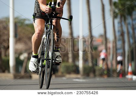 Cycling Competition,cyclist Athletes Riding A Race,racing Bike During Ironman Competition.racing- Bi