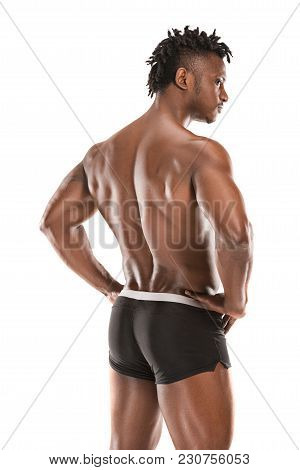 The Back Of Fit Young Man With Beautiful Torso, Isolated On White Background. The Naked Torso Of Afr