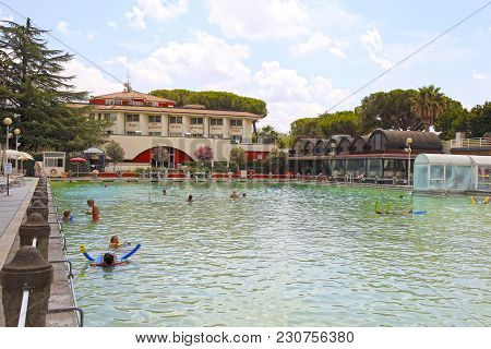 Viterbo, Italy - July 24 2016: People Relax In Natural Hot Pool Of Terme Dei Papi (meaning Spa Of Th