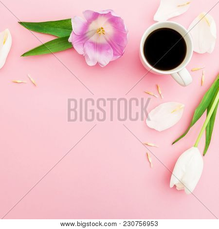 Composition With Tulips, Petals And Mug Of Coffee On Pink Background. Blogger Concept With Copy Spac