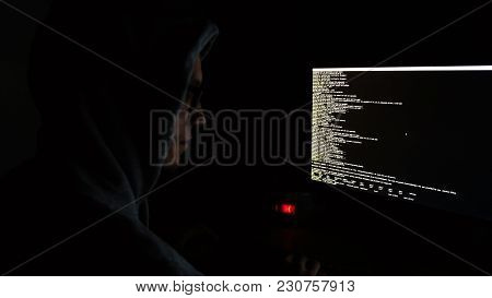 Hacker In The Hood Programs The Code In The Dark, The Command Line On The Monitor Screen, 4k