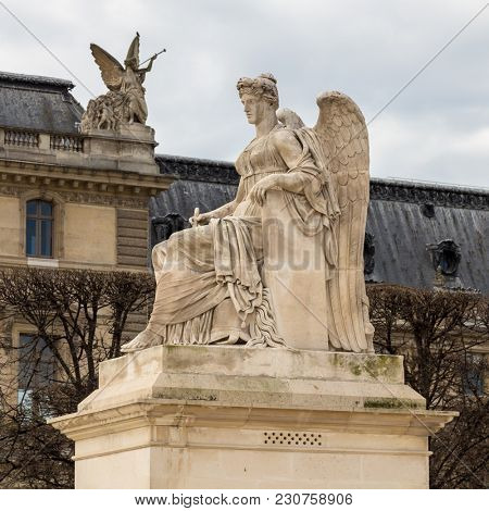 Angel statue at Triumphal Arch Arc de Triomphe du Carrousel at Tuileries. The monument was built between 1806 - 1808 to commemorate Napoleon's military victories