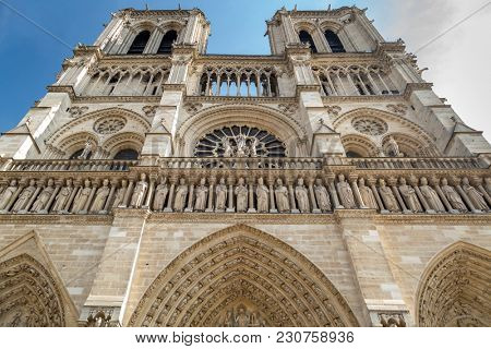 Paris, France - famous Notre Dame cathedral facade saint statues. UNESCO World Heritage Site
