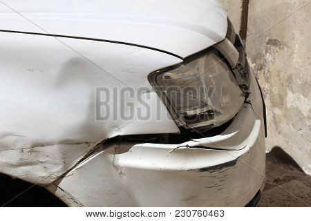 Generic Car With Scratched And Dented Front Wing. Minor Accident Result - Fender Bender.