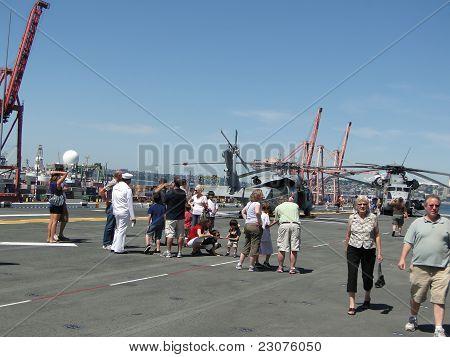 Civilians Inspect A Ch-53E Sea Stallion Helicopter,an  Mv-22 Osprey, And A Sh-60 Seahawk
