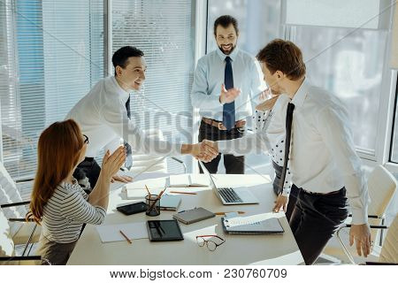 Nice To Meet You. Charming Upbeat Young Boss Standing At The Head Of The Table And Introducing The P