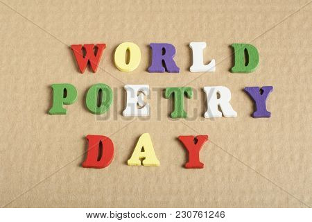 Text World Poetry Day Written On Wooden Cubes. Wooden Abc.