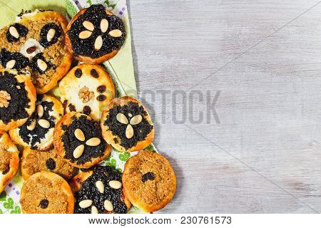 Group Of Yeast Cake With Poppy, Almond, Raisin And Cheese With Towel On White Wood