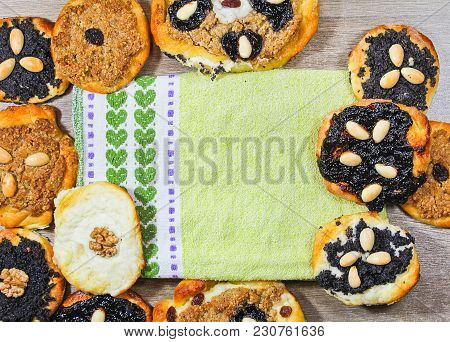 Home Made Yeast Cake With Poppy, Almond, Raisin And Cheese With Towel In Center
