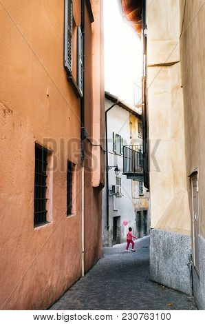 Chiavenna, Italy - 7 October, 2017: Boy In Pink Clothes Holding Pink Balloon Celebrates Breast Cance