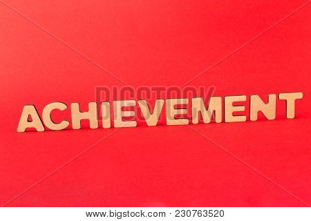 Motivation Poster. Word Achievement Spelled With Wooden Letters On Red Background. Success, Progress