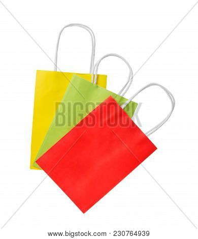 Three Shopping Bags. Red, Green And Yellow Color Pacage On White Background.