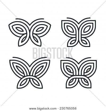 Set Of Four Stylized Geometric Butterfly Symbols, Celtic Knot Style Tattoo Design Or Logo. Isolated