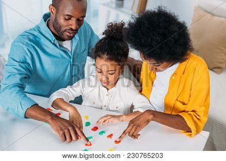 African American Parents Teaching Daughter Mathematics At Home