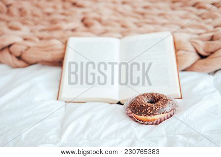 Sweet And Tasty Chocolate Icing Doughnut With Peanut Sprinkles On Woolen Bed Cover. Fast Food Tradit