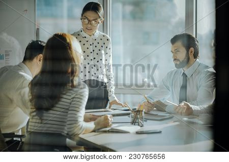 Caring Ceo. Considerate Female Boss Hearing Out The Concerns Of Her Employees While Having A Meeting