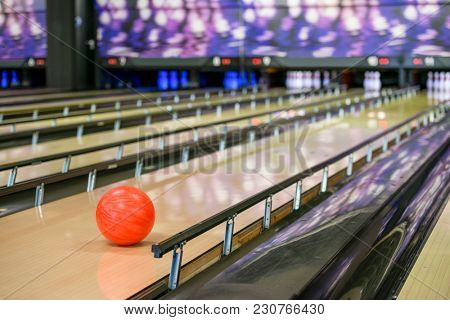 Orange ball on bowling alley