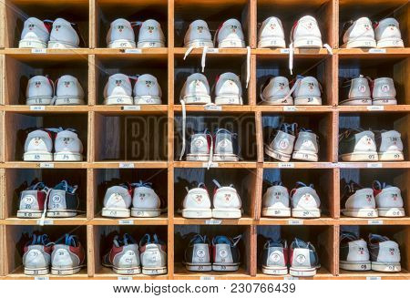 Full frame shot of bowling rental shoes in storage rack