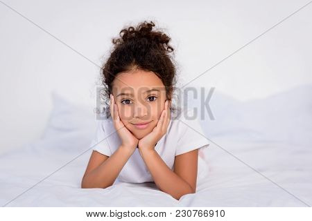 Adorable African American Kid Resting Chin On Hands At Home