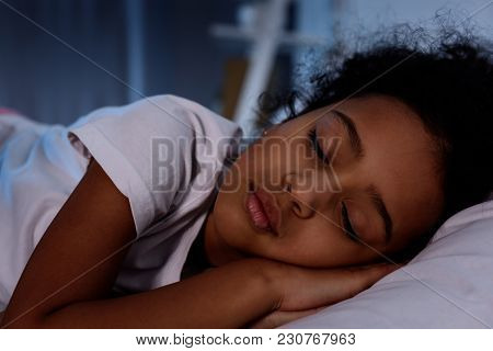 Adorable African American Kid Sleeping In Bed At Home
